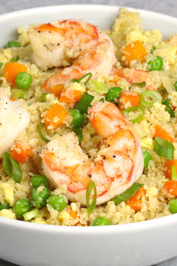 A serving of cauliflower fried rice with jumbo shrimp