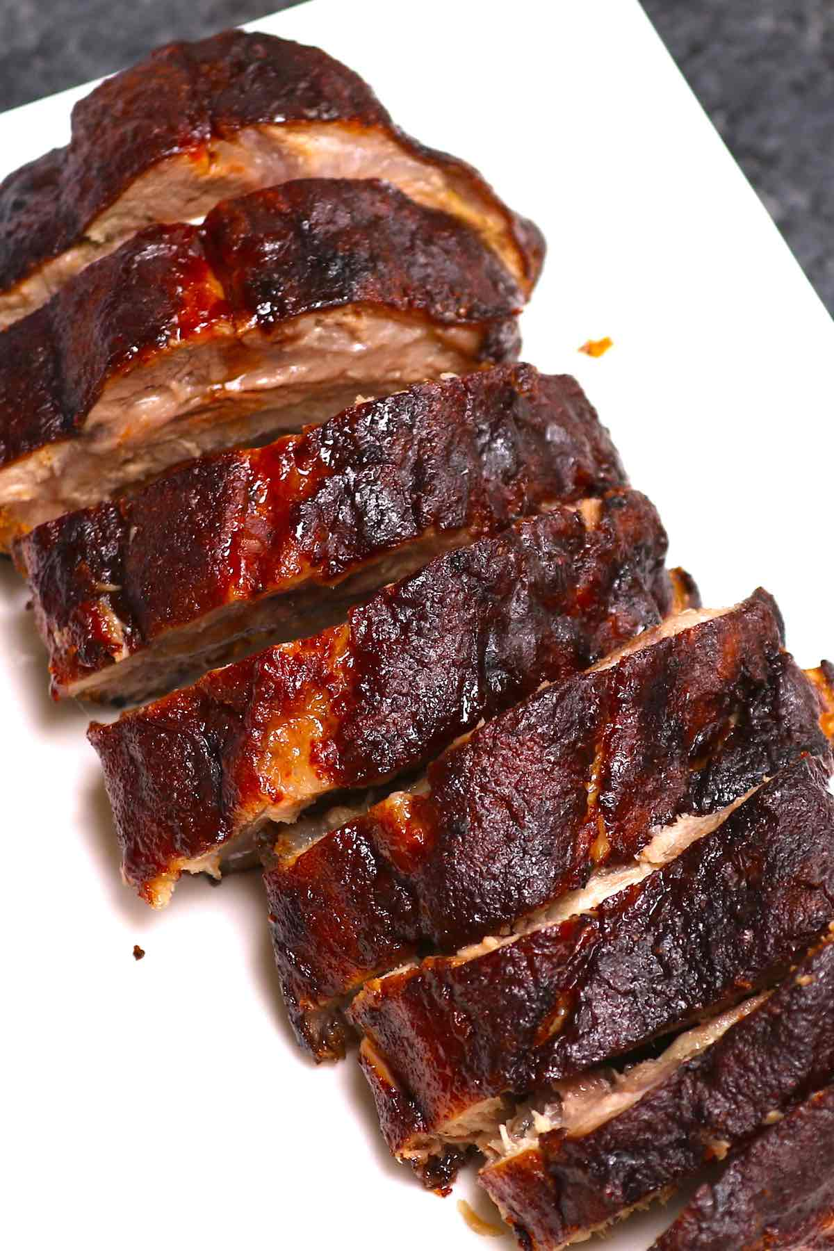 Overhead view of 3 2 1 ribs on a serving platter after having been cut into individual sections