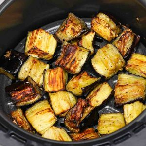 This Air Fryer Eggplant is a healthy and flavorful side dish that's ready in under 20 minutes! Keep reading to learn how to roast eggplant in an air fryer quickly and easily.