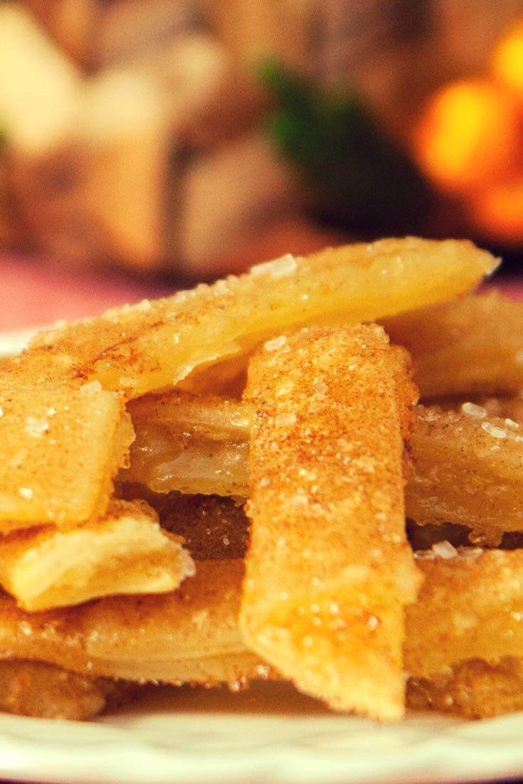 Delicious apple pie fries piled high on a serving plate