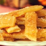 The Most Incredible Baked Apple Pie Fries: Delicious, crispy and healthy apple fries tossed with cinnamon sugar and baked to perfection golden brown color, drizzled with caramel sauce! All you need is a few simple ingredients: store bought pie crust, apple pie filling, cinnamon and sugar, nutmeg and milk. Quick and easy recipe, party desserts. Vegetarian. Video recipe.