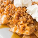 Super Easy Baked Apple Pie Nachos or Apple Pie Bites – delicious cinnamon sugary apple filling on warm, crispy and sweet nachos, topped with pecans, drizzled with caramel sauce, and then topped with whipped cream! The easiest dessert that comes together in no time. It's the perfect way to serve apple pie to a crowd! Quick and easy recipe. Great for party dessert and holiday brunch such as Easter, Mother's Day or Father's Day. Video recipe.