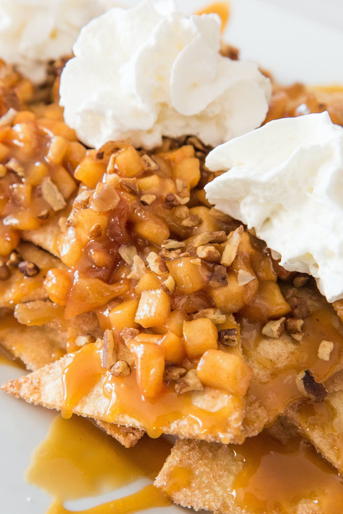 Apple Pie Nachos topped with whipped cream