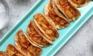 Super Easy Baked Apple Pie Tacos – delicious cinnamon sugary apple filling in a crispy and sweet taco, drizzled with caramel sauce, and then topped with whipped cream! The easiest dessert that comes together in no time. All you need is a few simple ingredients: Flour Tortillas, butter, cinnamon, sugar, apples, lemon, caramel sauce and whipped cream. It's the perfect way to serve apple pie to a crowd! Quick and easy recipe. Great for party dessert and holiday brunch such as Easter, Mother's Day or Father's Day. Video recipe. | Tipbuzz.com