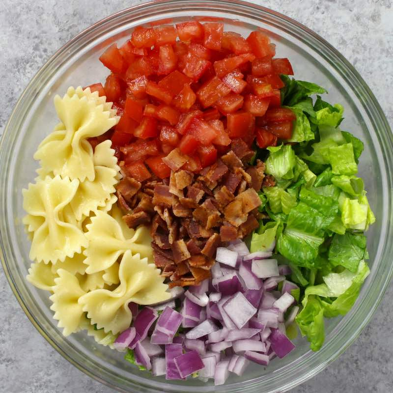 Here is a photo of the ingredients for BLT Pasta Salad arranged in a mixing bowl
