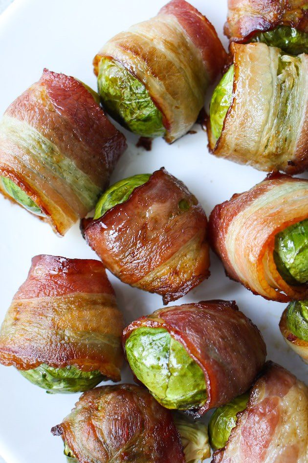 Overhead view of Bacon Wrapped Brussel Sprouts on a serving platter showing the beautiful color contrast of crispy bacon and green Brussel sprouts