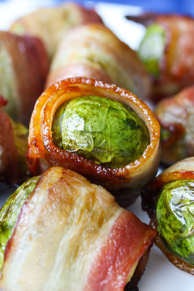 Closeup of bacon wrapped Brussel Sprouts on a serving platter