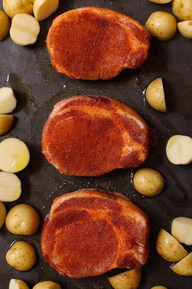 Dry rub seasoning on boneless pork chops before baking