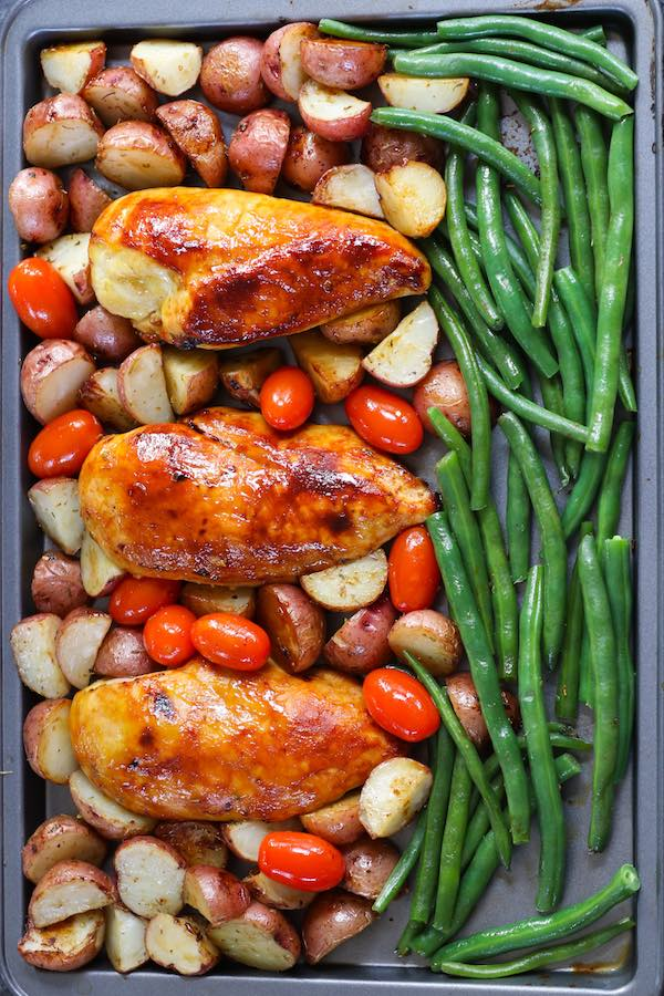 Overhead view of Chicken with Potatoes and Green Beans on a Sheet Pan after baking