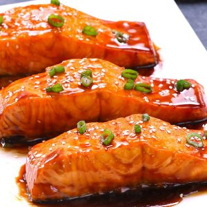 This Baked Teriyaki Salmon with Green Beans and Carrots is an irresistible dinner that's healthy and flavorful - moist salmon coated with a homemade sticky and sweet teriyaki sauce and baked to tender flaky perfection. The best Baked Salmon recipe ever! #teriyakiSalmon #bakedSalmon