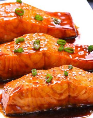 ThisBaked Teriyaki Salmon with Green Beans and Carrotsis an irresistible dinner that's healthy and flavorful - moist salmon coated with a homemade sticky and sweet teriyaki sauce and baked to tender flaky perfection. The best Baked Salmon recipe ever! #teriyakiSalmon #bakedSalmon