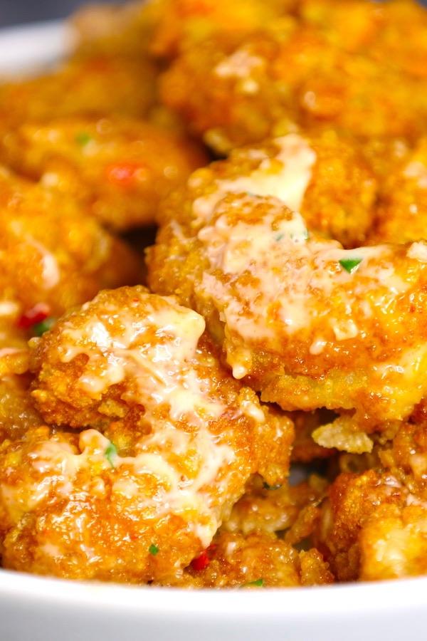 Bang Bang Shrimp is crispy and sizzling shrimp smothered in a creamy, sweet and spicy bang bang sauce. This easy recipe can rival the popular Bonefish Grill bang bang shrimp.