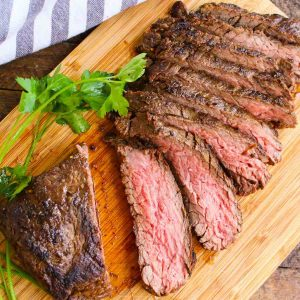 Sliced bavette steak on a carving board