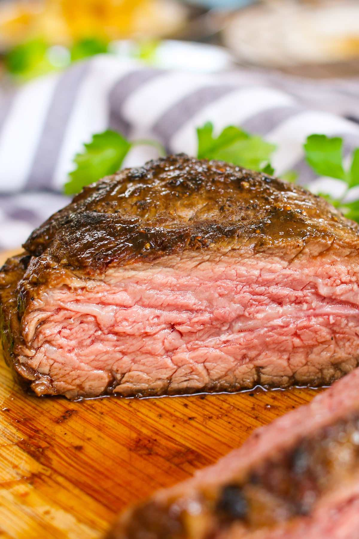 Cross-section closeup of a sirloin bib steak cooked medium of bavette steak cooked medium