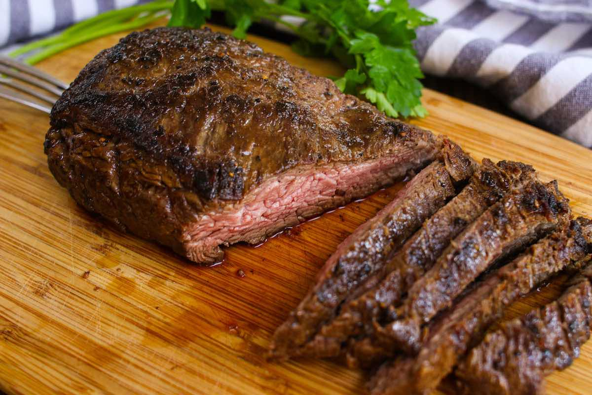Grilled bavette steak cooked medium and sliced crosswise against the grain to serve
