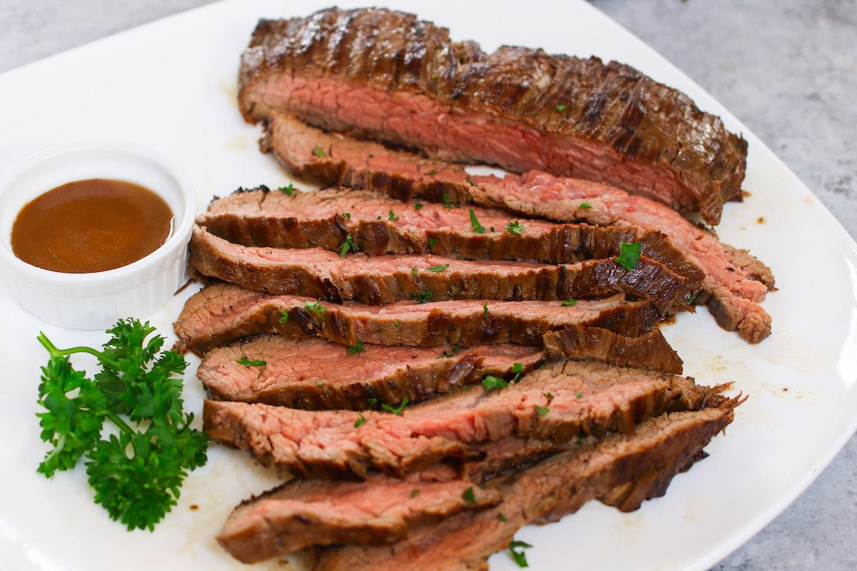 The Best Flank Steak Marinade makes super juicy and flavorful flank steak every time! Easy to prepare and perfect for grilling, pan frying, or broiling in the oven.
