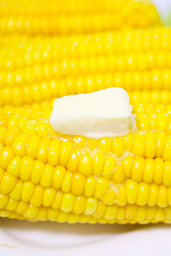 Boiled corn on the cob recipe brushed with butter and salt for the perfect side dish