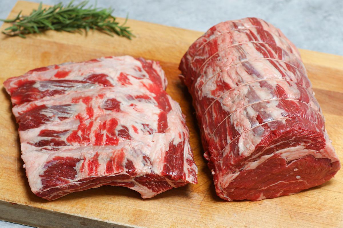 A prime rib separated into the boneless roast and bones