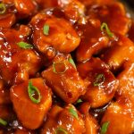 This Easy 20 Minute Bourbon Chicken is a copycat of the Chinese mall food classic: tender chicken coated in a tangy, sticky sauce with sweet and savory flavors. It's an easy weeknight dinner that's irresistible down to the last bite!