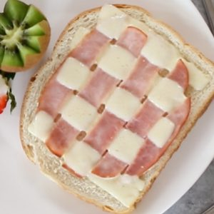 This Braided Ham and Cheese recipe brings a welcome twist to breakfast and brunch!