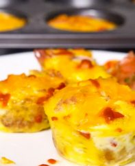 Egg Muffins or Breakfast Muffins with eggs, cheese, ham, onions, bell pepper and green onions cooked under 25 minutes - easy to make ahead and freezer-friendly. These Breakfast Egg Muffins are delicious and nutritious making everyone smile! #eggMuffins #breakfastMuffins
