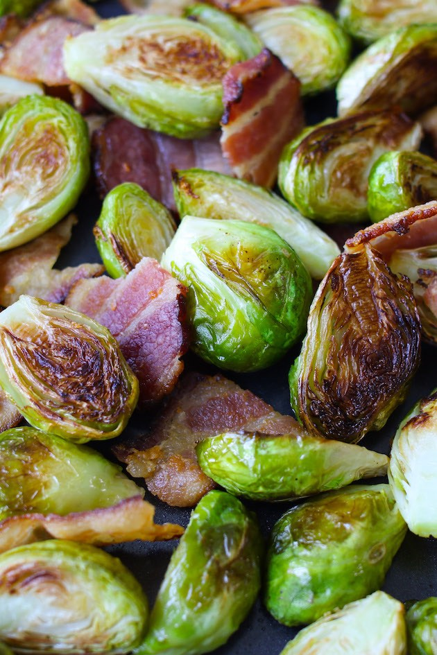 Oven baked brussels sprouts and bacon on a sheet pan
