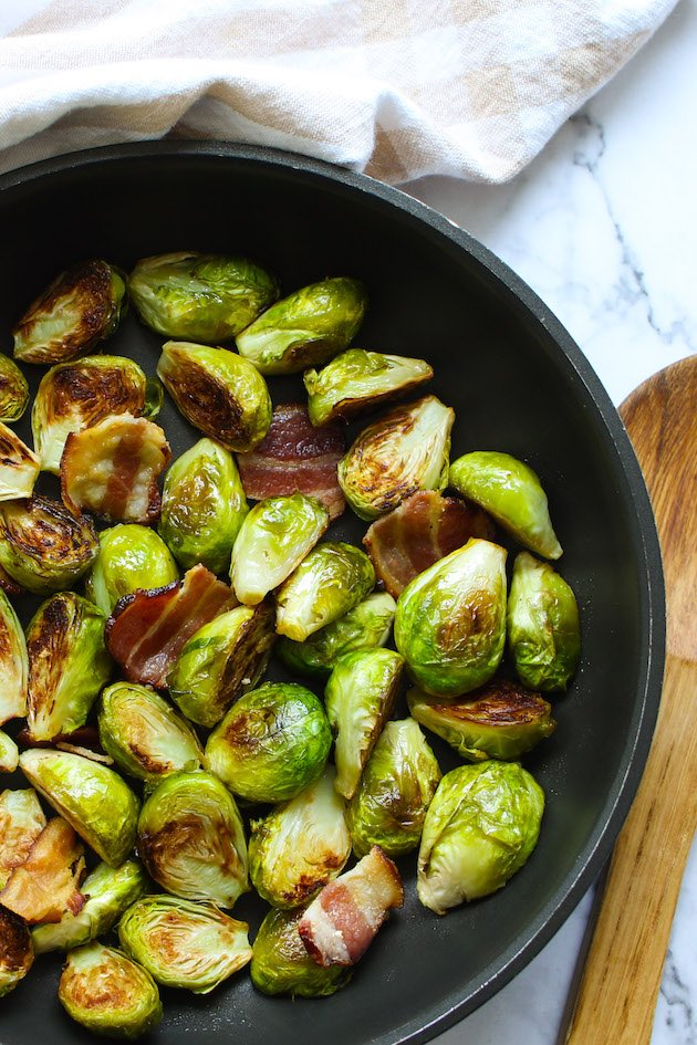 Sauteed Brussels sprouts and bacon in a frying pan
