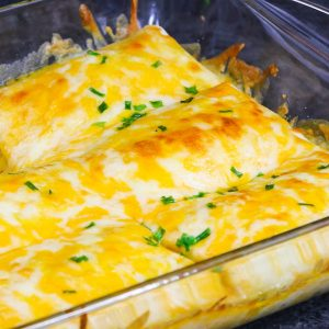 This Cheesy Burrito Casserole is the ultimate homemade Tex Mex recipe. It's loaded with beef, beans, onions, corn and seasonings for a mouthwatering meal