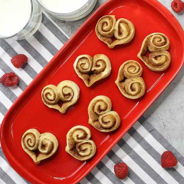 Heart Shaped Cinnamon Rolls on a holiday-themed serving platter