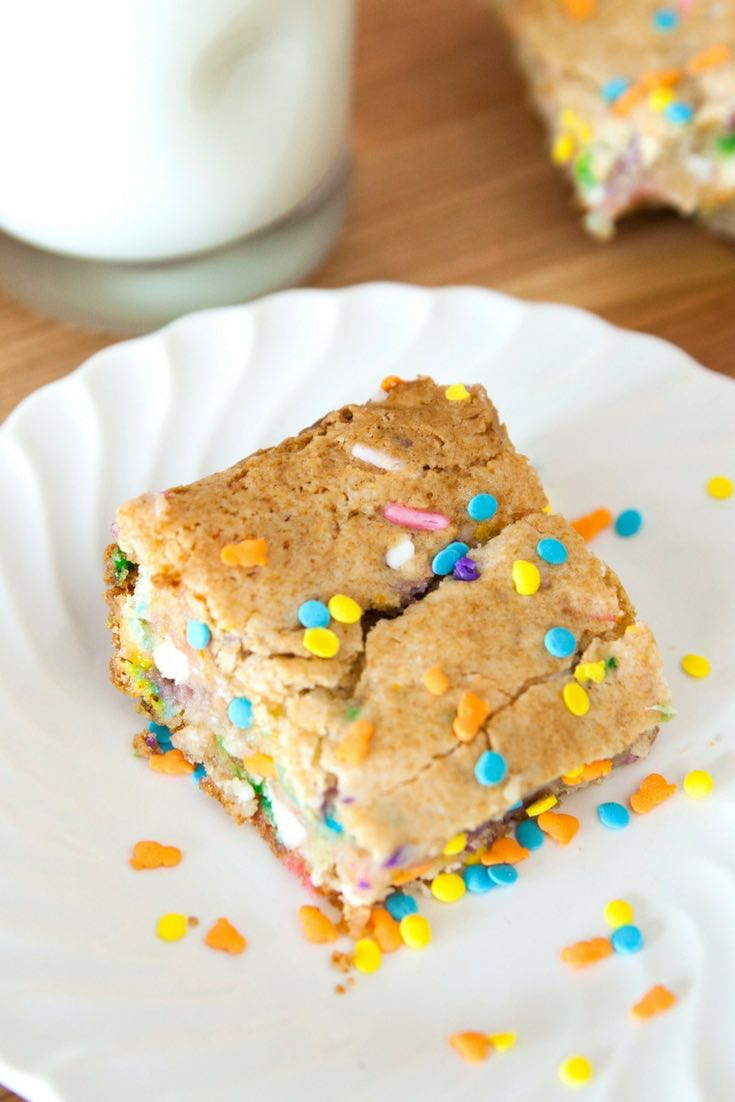 Cake Batter Blondies on a serving plate with colorful sprinkles