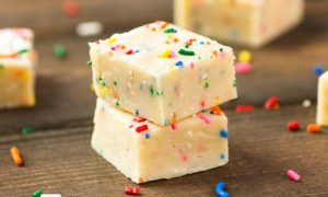 This Cake Batter Fudge recipe is a delicious dessert idea combining white chocolate and fudge flavors. Perfect for a party or just a casual snack with friends. Video recipe.
