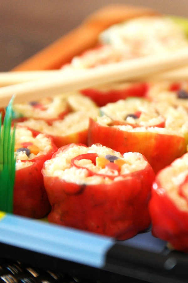 Candy Sushi is a delicious DIY treat made with fruit rollups, puffed rice cereal, melted marshmallows and candy in the middle for a coloful snack that's also gluten-free