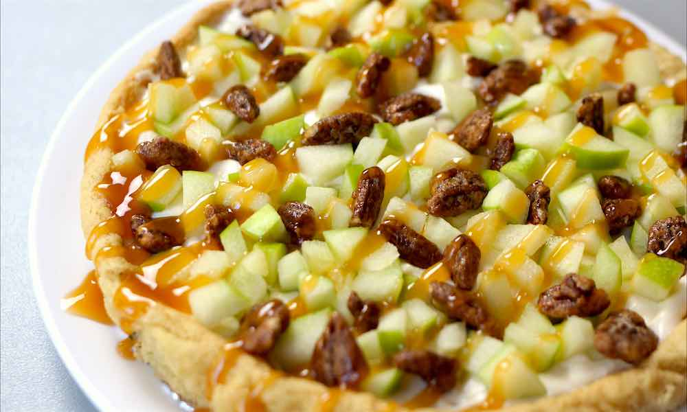 This easy Caramel Apple Fruit Pizza recipe is a delicious way to enjoy crips apples with pecans and caramel