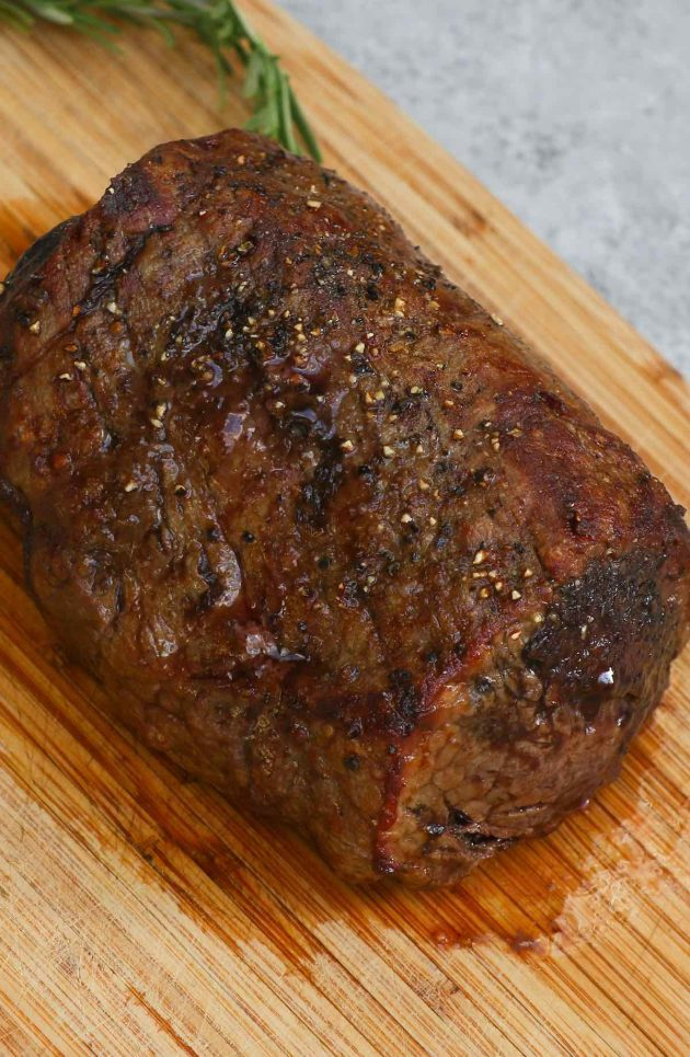 A beef tenderloin roast with a beautiful sear on the outside