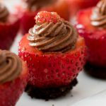 No Bake Strawberry Cheesecake Bites – Smooth and creamy chocolate cheesecake stuffed in fresh strawberries, all in one bite! A simple and delicious, quick and easy recipe that make a great finger food dessert for parties, brunch, or as an afternoon snack! Great for Mother's Day! Party food, party dessert recipes. Video recipe. | Tipbuzz.com