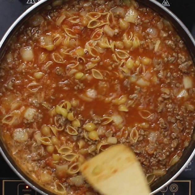 Taco Pasta being prepared after pasta and water are added to the meat sauce when making this one pot meal