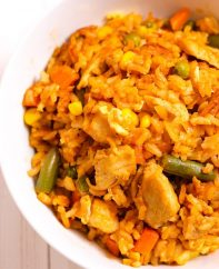 Chicken Fried Rice with eggs, chicken, rice, peas, green beans, onion, corn and carrots in under 20 minutes better than your favorite Chinese takeout restaurant. Irresistibly delicious. #ChickenFriedRice #FriedRice