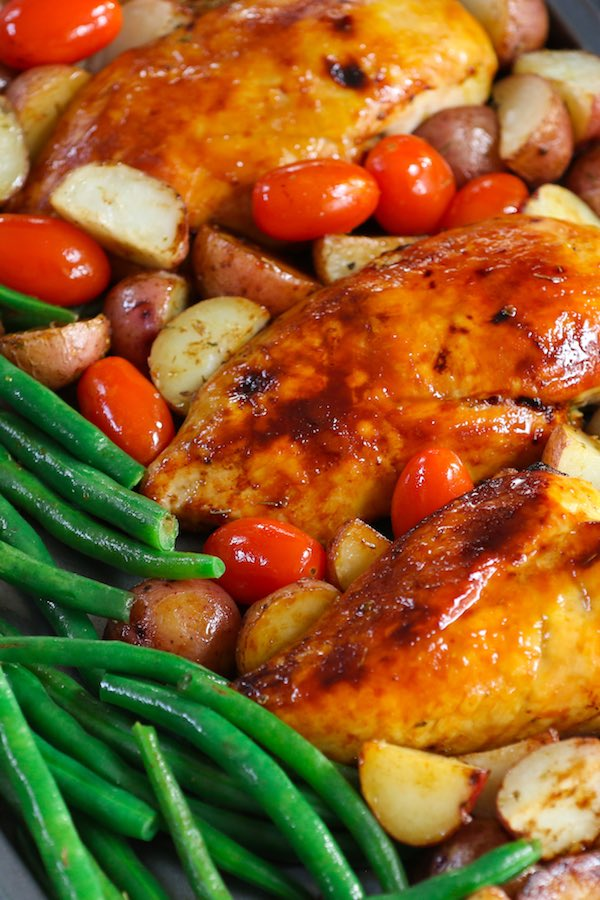 It doesn't get tastier or healthier than this tender and juicy Chicken with Potatoes and Green Beans. It's a simple one-pan wonder dish seasoned with Italian spices and roasted to perfection. Easy to prepare with quick cleanup, it's guaranteed to please! #BakedChickenBreast #ChickenPotatoesGreenbeans
