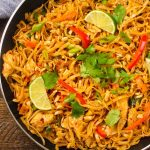 This Pad Thai is a favorite Thai noodle dish that's sweet and nutty, balanced with salty and spicy accents. Chicken Pad Thai is the perfect meal for a week day dinner that comes together in less than 20 minutes.