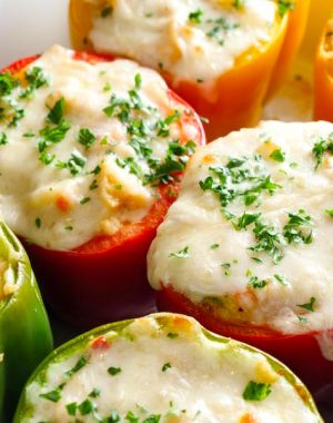 These Stuffed Bell Peppers have a simple filling using creamy chicken noodle soup as the base combined with breadcrumbs and parmesan for an easy side dish everyone will love