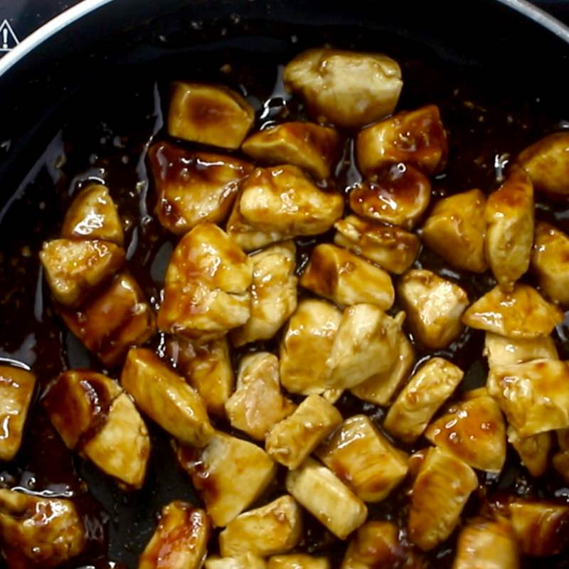 Chicken Teriyaki - this photo show the teriyaki sauce starting to thicken and coat the chicken pieces in a skillet