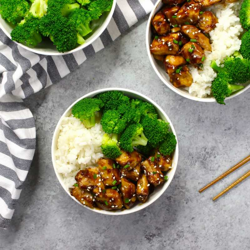 Chicken Teriyaki bowls - this photo shows chicken teriyaki served with broccoli in rice bowls
