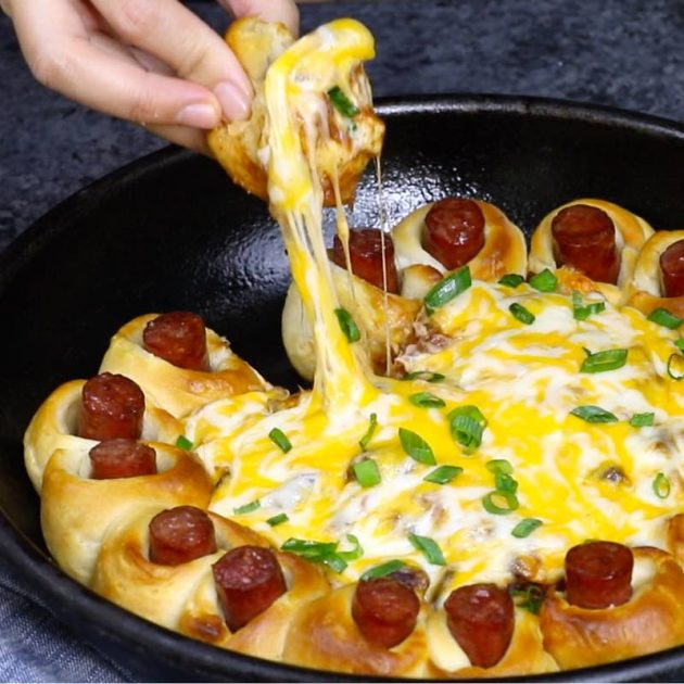 Chili Party Ring – this photo shows a cheese pull while serving this delicious appetizer
