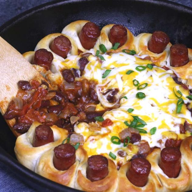 Chili Party Ring - this photo shows bean chili being served with a spatula next to pieces of hot dog baked in biscuit dough - so good!
