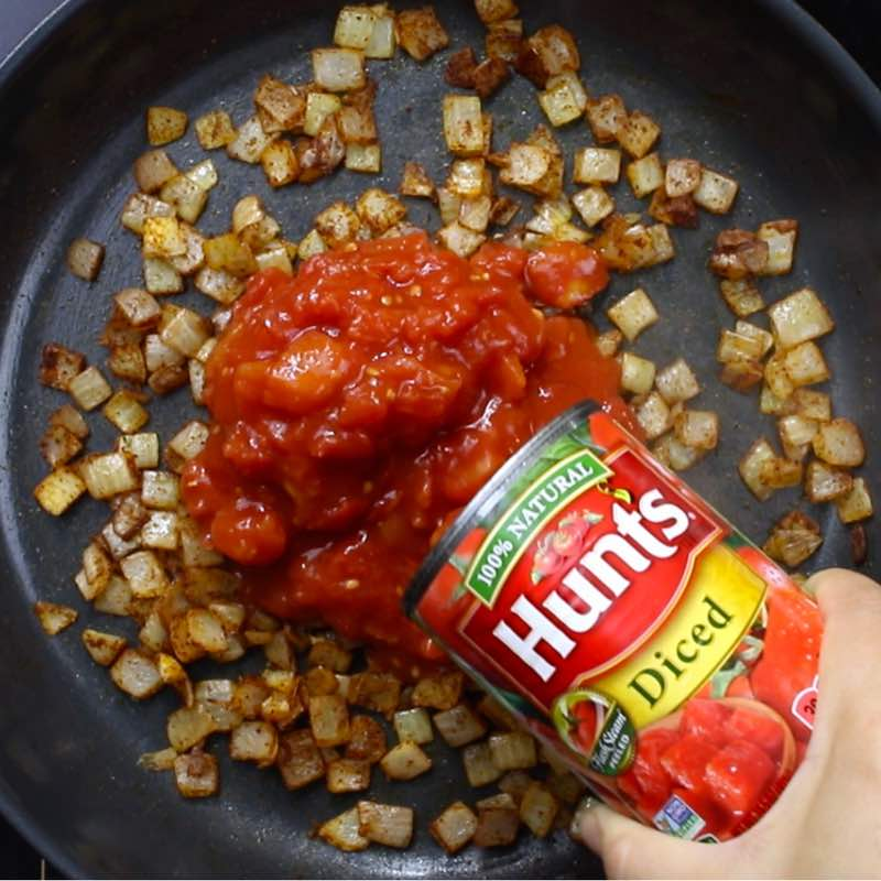 Chili Party RIng - this photo shows adding Hunt's diced tomatoes to the chili mix in skillet #AD