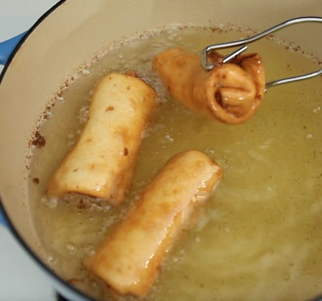 Deep frying chimichangas in a medium saucepan