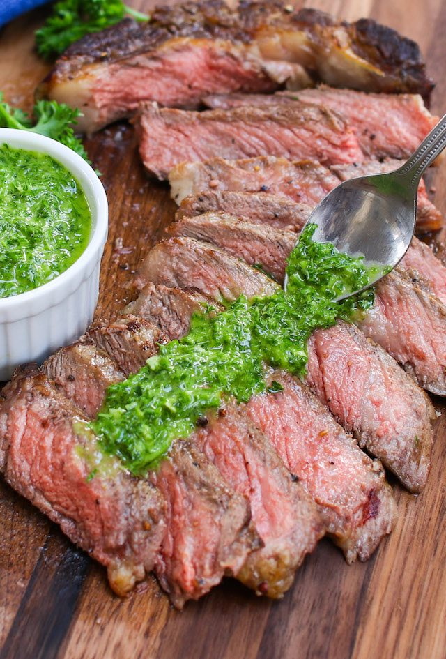 Chimichurri Steak is a quick and easy recipe cooked in 15 minutes with no marinating needed! Perfectly seared steak is served with garlicky, tangy and flavorful chimichurri sauce.
