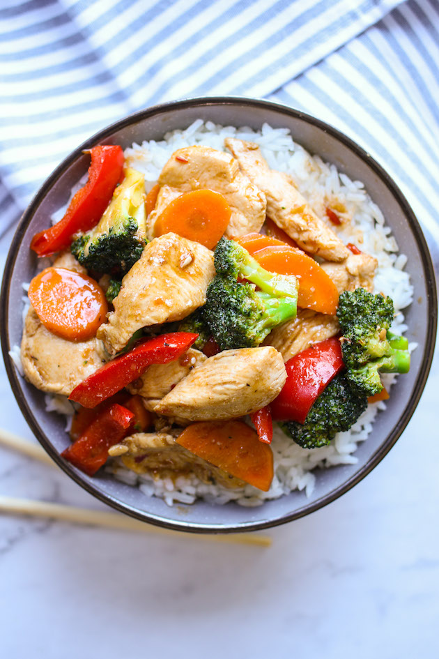 Spicy Chinese chicken and broccoli stir fry served in a rice bowl