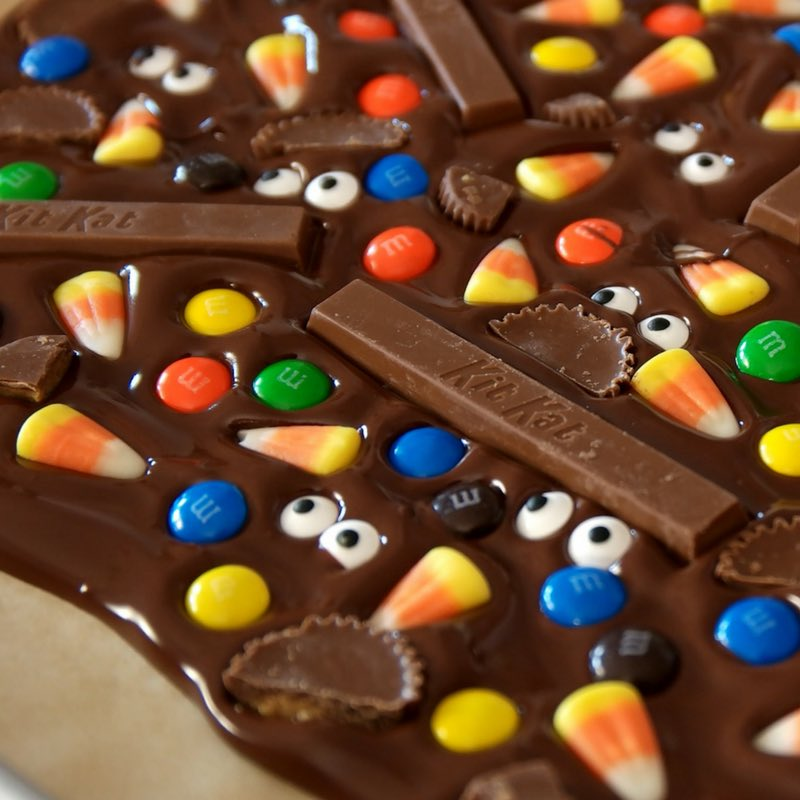 This photo shows freshly made Halloween Chocolate Bark on a baking sheet