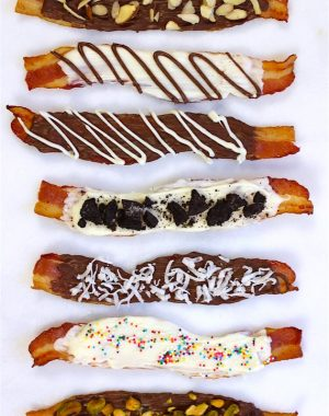 Chocolate covered bacon made six different ways including with dark chocolate, white chocolate, nuts and sprinkles